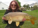 Ms Cerri Meadows with a 12lb Mirror caught in the House Pool