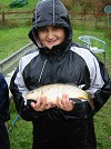 "Local school lad with his first Common Carp caught during the ""school's day"" at Nineoaks"
