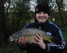 Young Daniel Purton of New Quay with his 6 1/2lb Carp caught using Sweetcorn on a cold day