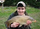 youngster, Jake with a 5lb superbly conditioned Common from the Main Lake