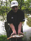 Local angler, Carl with one of our hard fighting Barbel.
