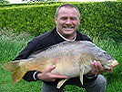 Gary from South Wales with a lovely 24lb Mirror caught on a large piece of Luncheon meat and a borrowed rod!
