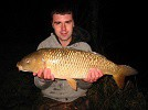 Large Common Carp caught by local Mark on sweetcorn after a hard fight