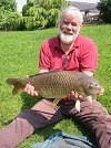 Retired science teacher Chris with a superb 16lb Common