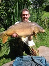A photograph of Mike Evans (July 2006) with his the 25lb Mirror Carp