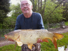 Visiting angler, Mike Shenton with a cracking Common from the Main Lake