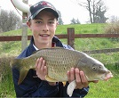 young Harry Studt of New Quay (Wales) with a 6 1/2lb Common Carp.