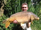 Mike Evans of Newtwon with his 25lb Mirror caught using a portion of fresh raw sausage