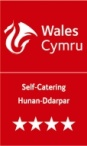 The official logo of the Welsh Tourist Board for property accredited by them with a 4star rating